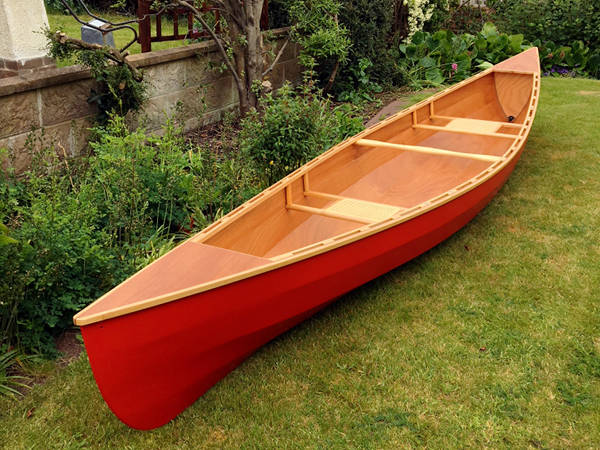 A well-finished Canadian canoe with standard broken inwales and optional seats