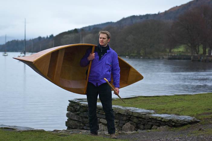 A lightweight wooden Canadian canoe is easily carried