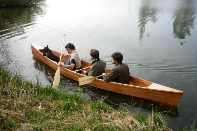 Canadian canoe - a lightweight wooden open boat that is easy to paddle