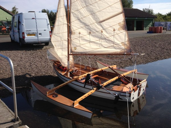 Fyne Four sailing dinghy with Michael Storer outriggers