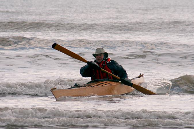 Surfing in a sea kayak