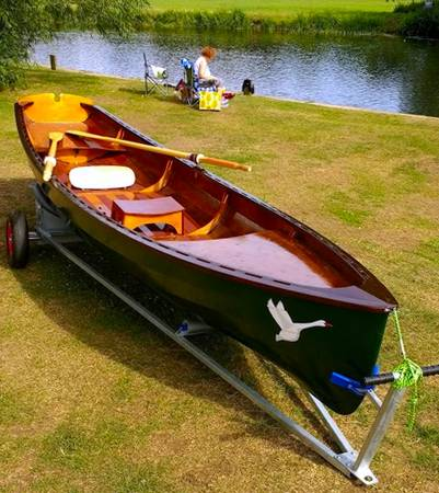 The Chester Yawl is a clinker-style wooden rowing boat with high freeboard