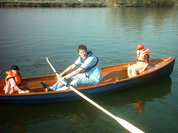 Family adventure in a rowing boat built in the garage