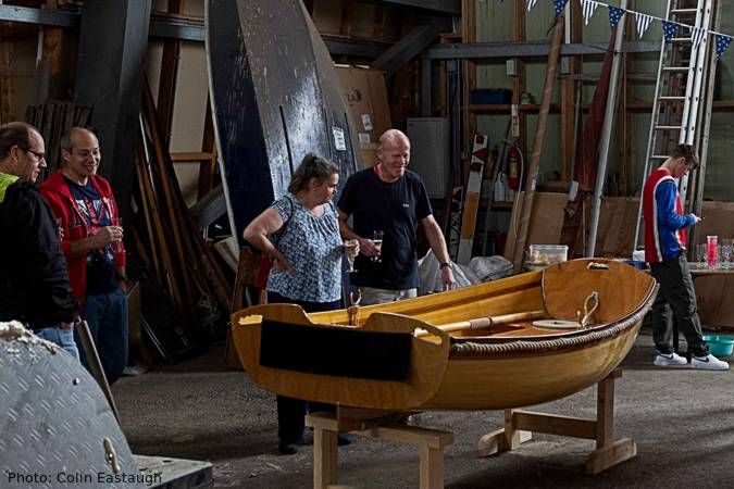 The Coot is a wooden rowing boat built using the cedar-strip method