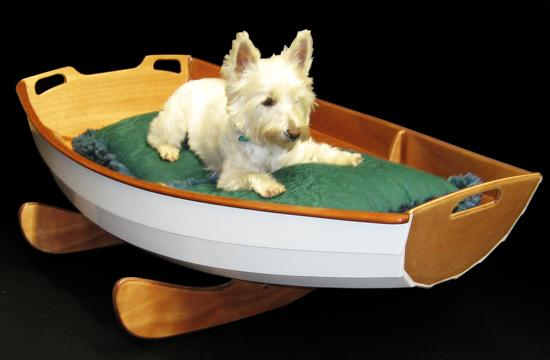 Cradle boat as a bed for a small dog