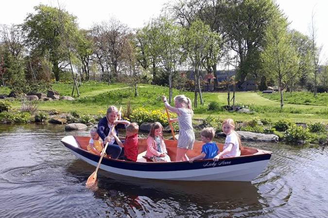 The Dinky Dory is a clinker-style wooden rowing boat