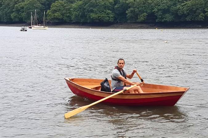 A lightweight wooden rowing boat built on a course at Fyne Boat Kits