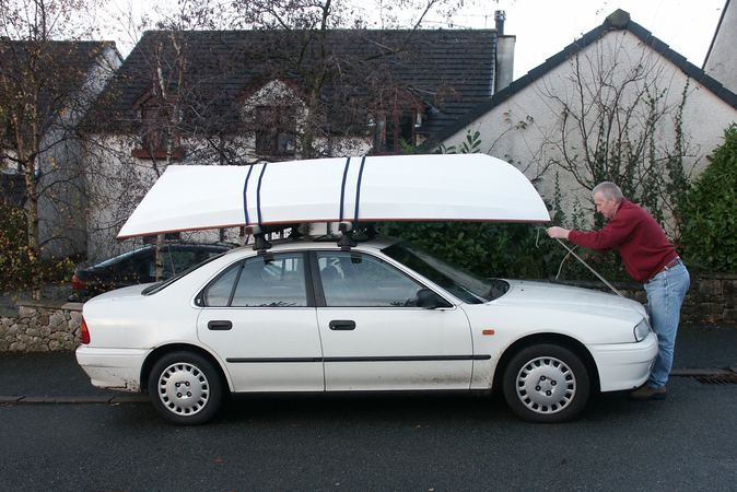 Wooden dory fits on a car roof rack