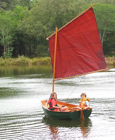 Children messing about learning to sail in a home made Eastport pram dinghy