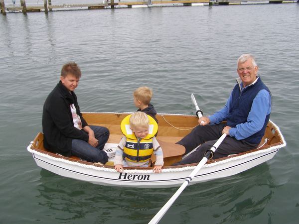 Family in an Eastport Pram that they built