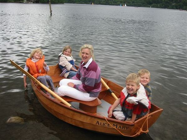 Children and Grandmother having fun messing about in Granddad's home made clinker rowing boat
