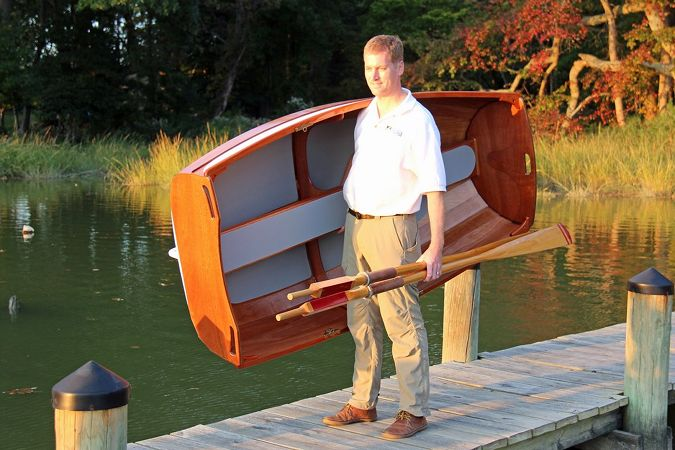 Carrying the Eastport Ultralight Dinghy using the bench seat as a handle