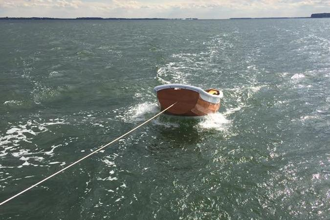 The Eastport Ultralight Dinghy tows light and dry, with the bow well clear of the water