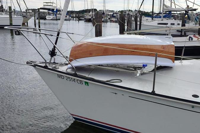 Ultralight tender designed to fit on the foredeck of a small yacht