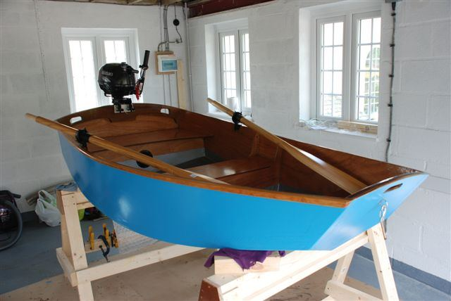 Puting the finishing touches to a home made diy motor boat