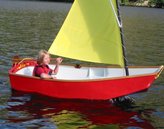 Girl having fun learning to sail a small boat