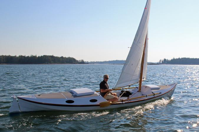 The Faering Cruiser can be rowed and sailed and has a small cabin aft