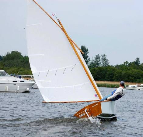 The Goat Island Skiff is a simple lightweight wooden sailing dinghy