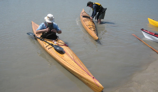 Great Auk stable cedar-strip sea kayaks with plumb ends, soft chines and a rounded bottom