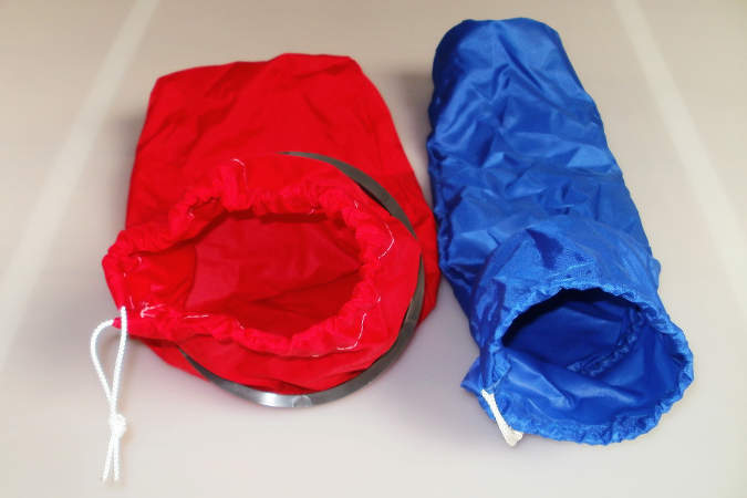 Drawstring bags that fit inside the rim of boat inspection hatches