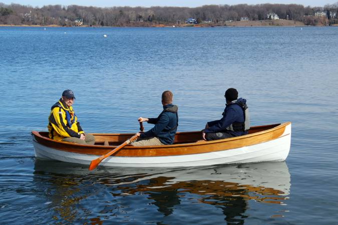 A modern wooden rowing boat based on a traditional Maine Peapod