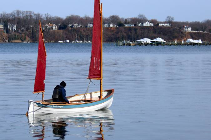 A stable but fast double-ended rowing or sailing boat based on a traditional Maine Peapod