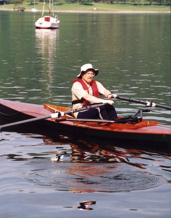 Row a canoe with a sliding seat
