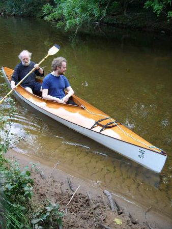 A tandem kayak with a large cockpit that feels like a very buoyant and safe canoe