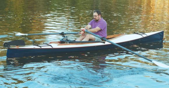 Sliding seat rowing of a canoe