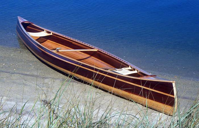 The Mystic River tandem canoe on a beach