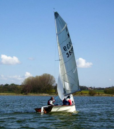 Home made National 12 racing boat under sail