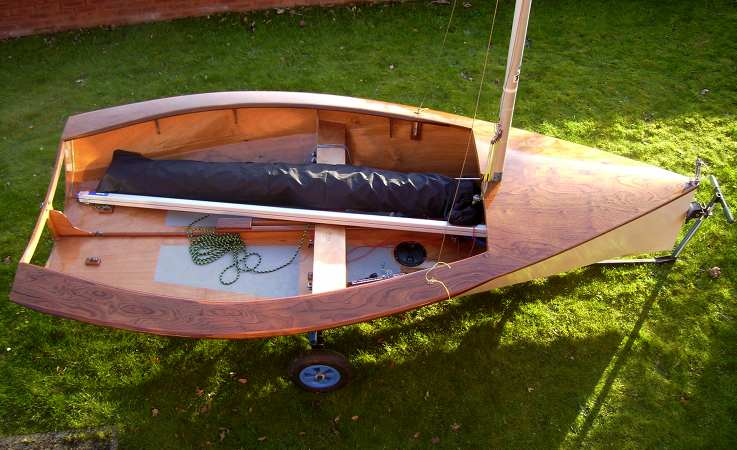 Lightweight wooden National 12 with a varnished deck
