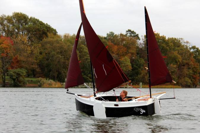 The Nesting Expedition Dinghy is a very compact wooden sailing boat for beach cruising