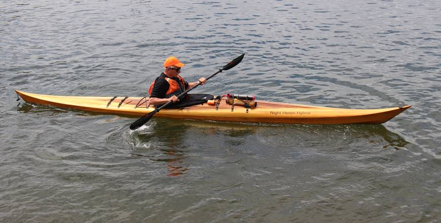 Hybrid Night Heron high-decked sea kayak with a cedar strip deck