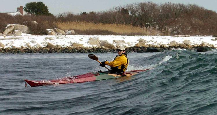 Surfing a Night Heron stitch-and-glue sea kayak