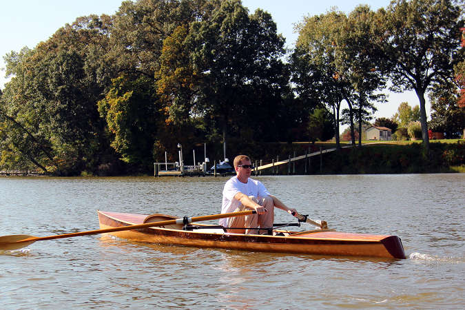 The Noank Pulling Boat is an efficient wooden sculling boat suitable for open water expeditions, using a drop-in sliding seat rowing unit