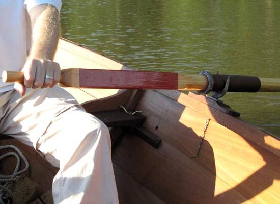 Traditional wooden oars with leather collars