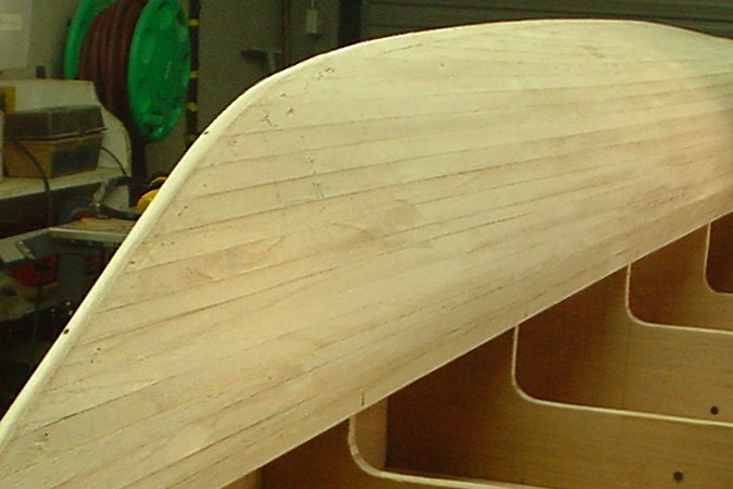 Strip-planking a wooden boat with Paulownia strips