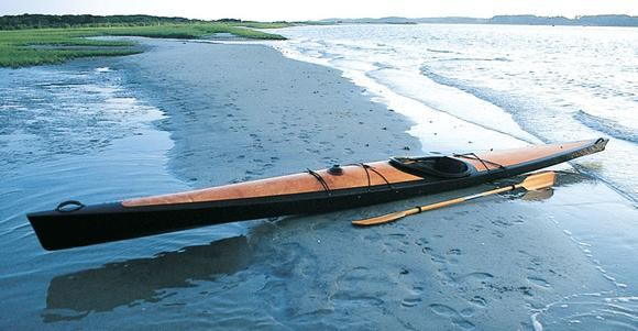 A beautiful Pax 20 wooden kayak on the beach