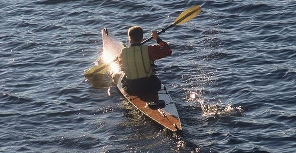 Paddling late into the evening in a home built kayak