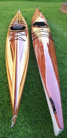 A pair of Pax wooden kayaks with custom cedar strip decks