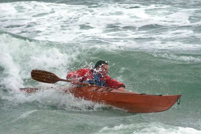 Surfing in the Petrel Play stitch-and-glue sea kayak