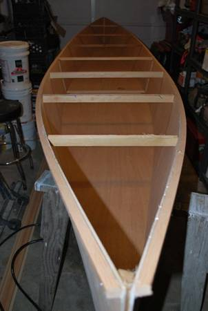 Spacers create the hull shape and are removed when the boat is glued together