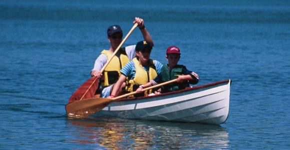 A fun family Sassafras double open canoe that will take three adults or children