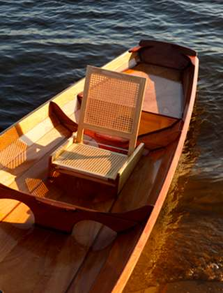 Folding cane seat for a canoe or boat
