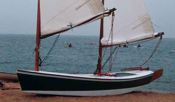 The 18 foot Sharpie sailing boat is easily beached, thanks to the retractable daggerboard