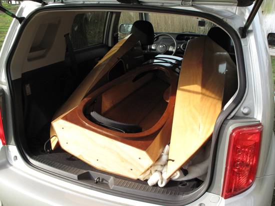 The sectional Shearwater Sport kayak fits in a car