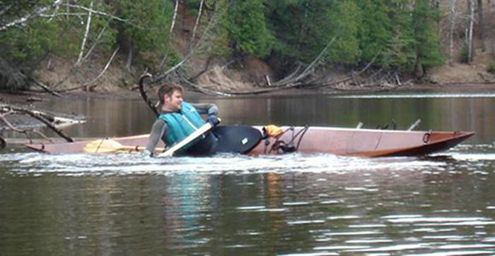 Steering a wooden kayak