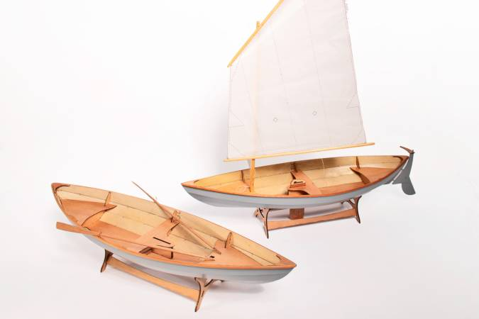 A scale model of the Skerry, rowing and sailing versions compared