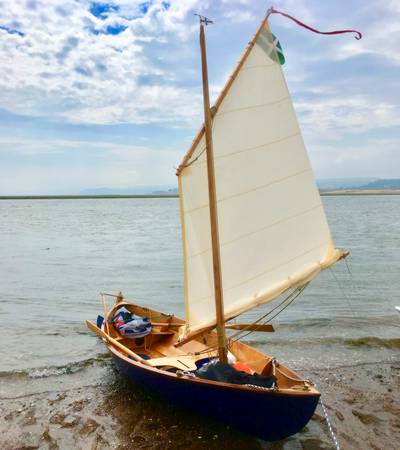 A lug-rigged Skerry, a home-built wooden sailing boat